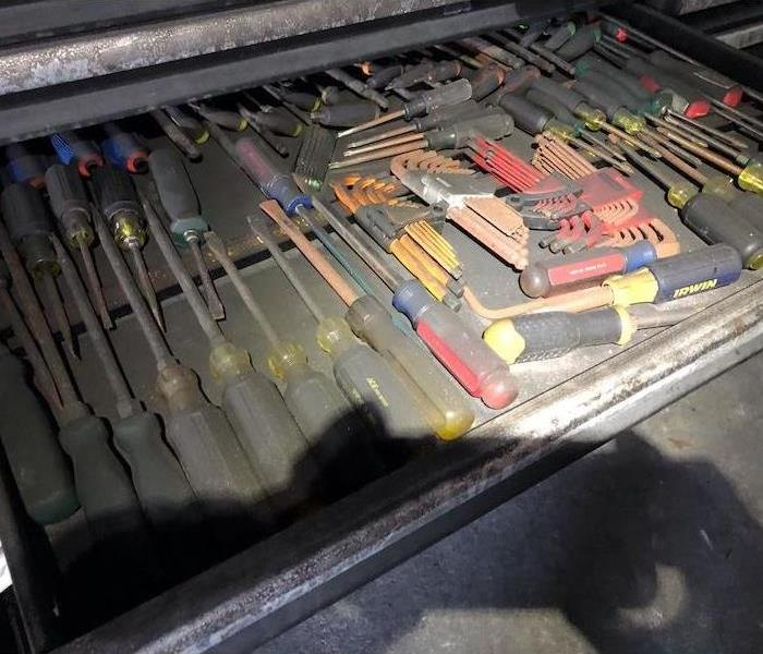 Tools in toolkit covered in smoke damage