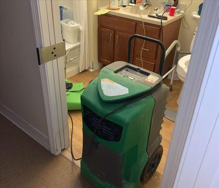 SERVPRO dehumidifier and air mover in bathroom