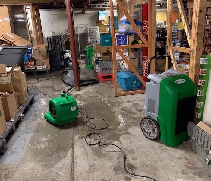 Basement with SERVPRO drying equipment running