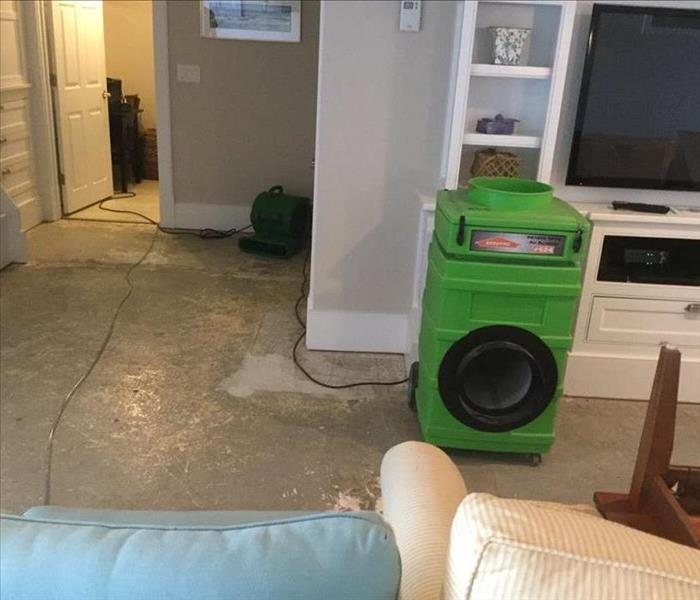 Move furniture, bare floor, water removed and two units purifying the air