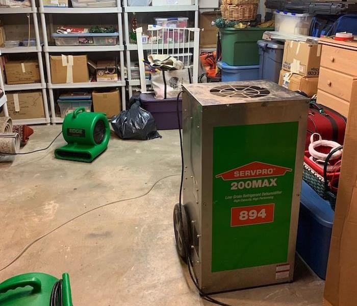 Basement with SERVPRO air movers and dehumidifiers