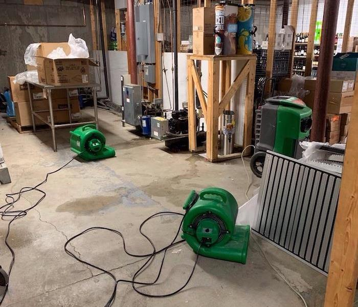 basement with drying equipment active