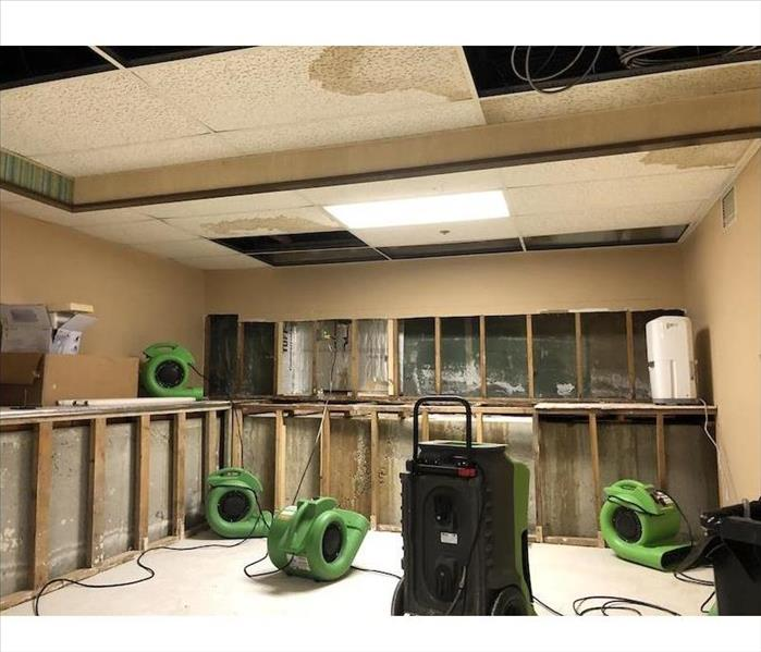 Room with exposed framework and SERVPRO equipment