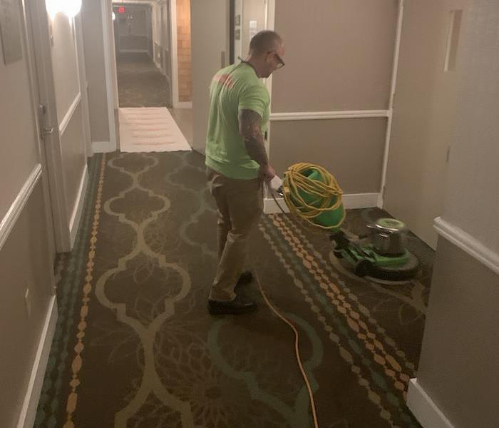SERVPRO tech with cleaning equipment