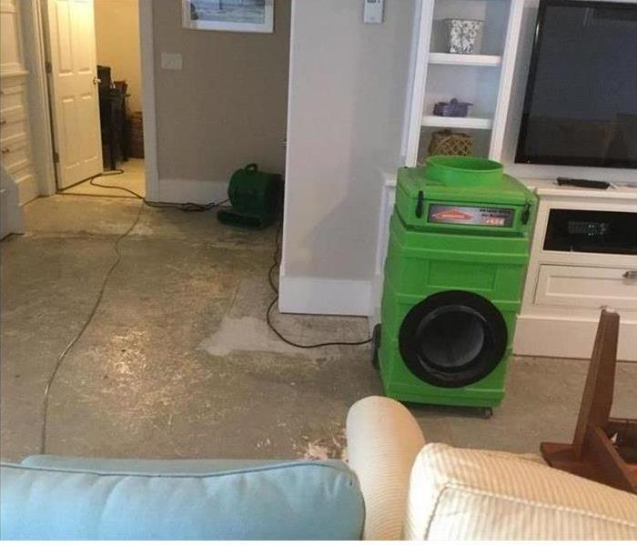 One of our green machines extracting water from the wet carpet in this home