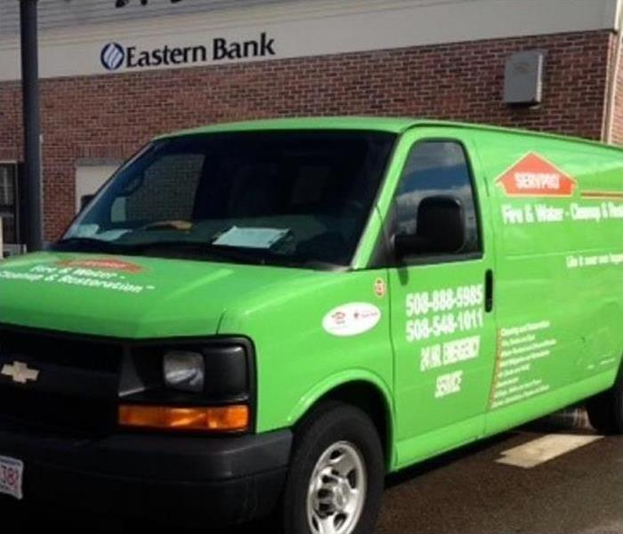 One of our green vans in the parking lot of a business