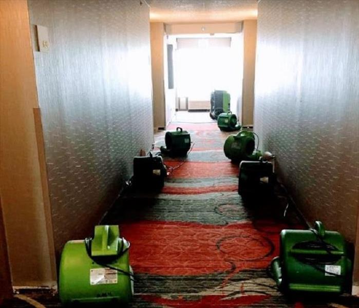 SERVPRO drying equipment being used in hotel hallway