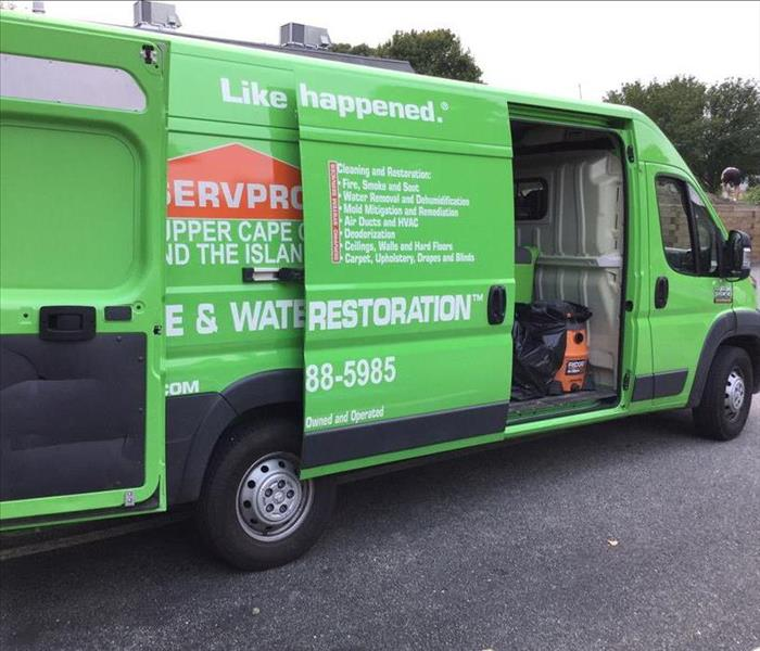 A SERVPRO van with the door open