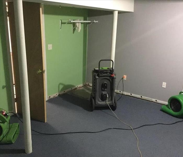 Air dryers and a dehumidifier circulates air in the room and into small holes in the walls